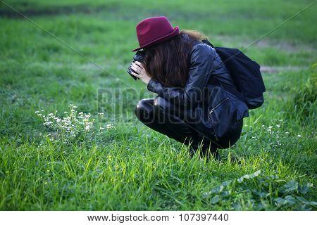 Female Photographer On Grass