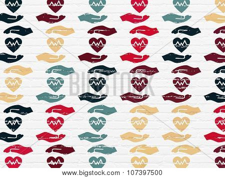 Insurance concept: Heart And Palm icons on wall background