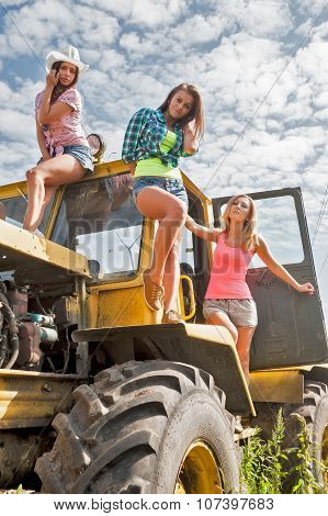 Beautiful women on old big tractor