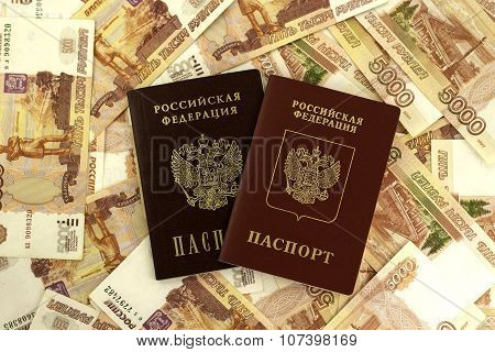 Russian foreign and domestic passport on a background of money