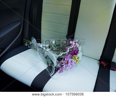 dahlias bouquet on car rearr seat