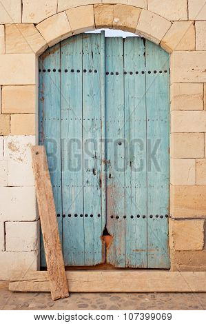 Blue wooden door of an old store in Limassol Cyprus