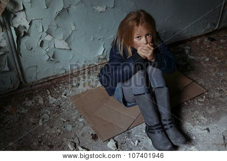 Hopeless girl sitting on the floor