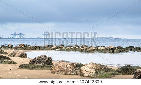 Rocky Beach On The Gulf Of Finland. Port Of Sillamae, Estonia
