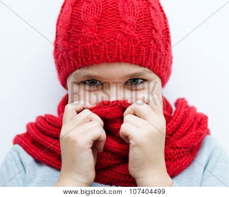 Smiling Girl Wearing A Hat And Scarf