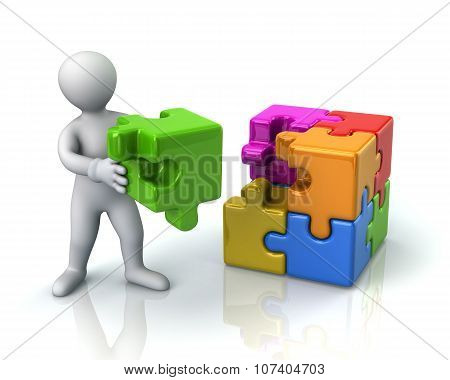 Man And Colorful 3D Puzzle Cube With A Missing Piece