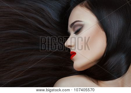 Close-up Face Of A Girl With Lush Hair.