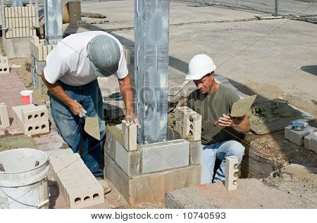 Bricklayers Installing Soldiers