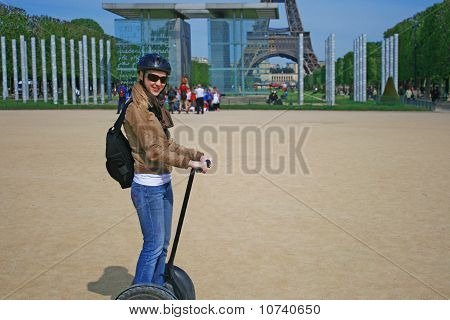Lady Riding A Segway Machine In Paris