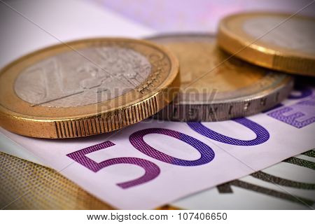 Coins And 500 Euro Banknotes
