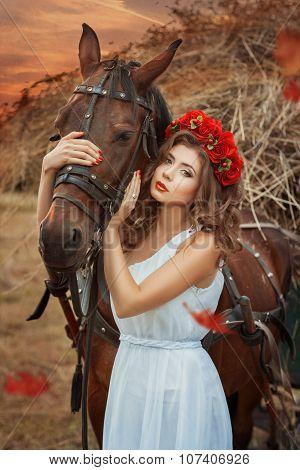 Girl Hugging A Horse Head.