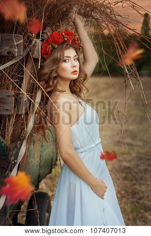 Pretty Girl Leaning On A Hay Wagon.