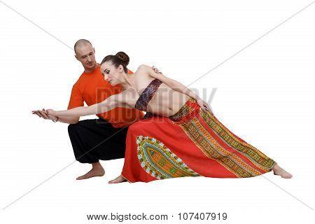 Yoga. Professional coach helps to perform asana