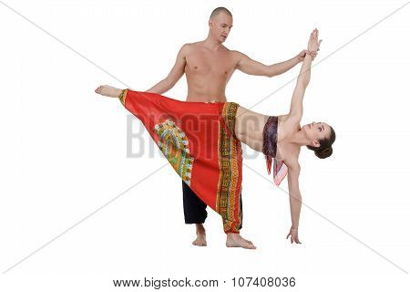 Yoga. Middle-aged man and woman training