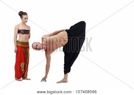 Woman watches as yoga instructor performs asana