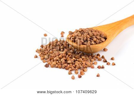Uncooked Buckwheat On Wooden Spoon