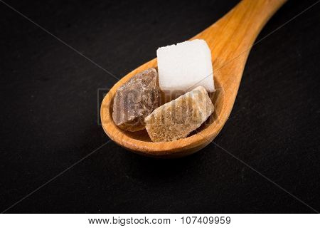 White Refined And Brown Sugar In Wooden Spoon