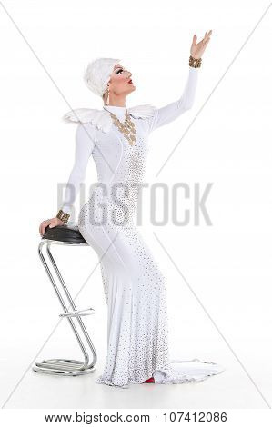 Drag Queen In White Dress Performing