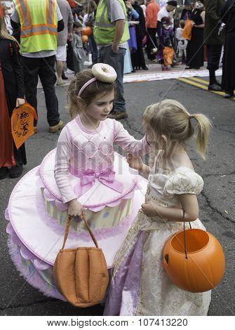 Warrenton, Virginia, USA-October 26, 2015: Little girls in costumes walking in The Halloween Happyfe