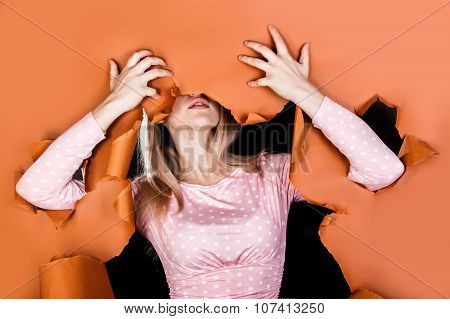 Young Woman Tearing To Pieces A Brown Paper