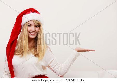Woman In Santa Hat With Empty Hand For Copy Space