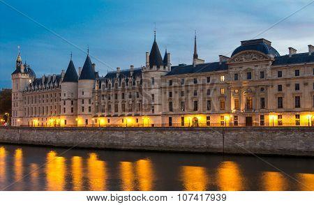 The Castle Of Conciergerie At Night , Paris, France.