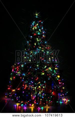Decorated Christmas tree lit up with colorful lights at night