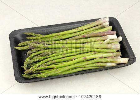 Raw Asparagus In A Plastic Tray