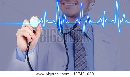 Stethoscope in doctor hands with cardiogram