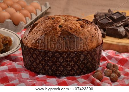Dark chocolate traditional panetone on rustic ambient, traditional Christmas food.