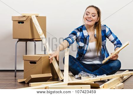 Woman Moving Into Apartment House.