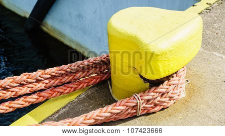 Bollard Trussed Wrapped With Mooring Rope.