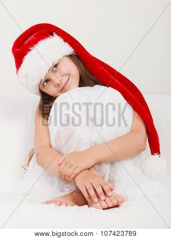 Little Girl Kid In Santa Claus Hat. Christmas.