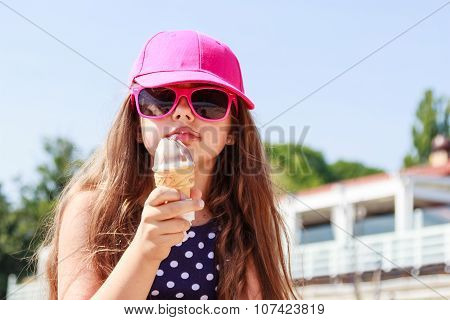 Little Girl Kid Eating Ice Cream. Summer.