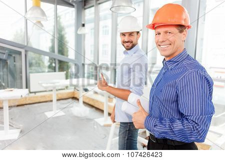 Professional male engineers are satisfied with their work