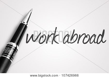Pen Writes Work Abroad On White Blank Paper