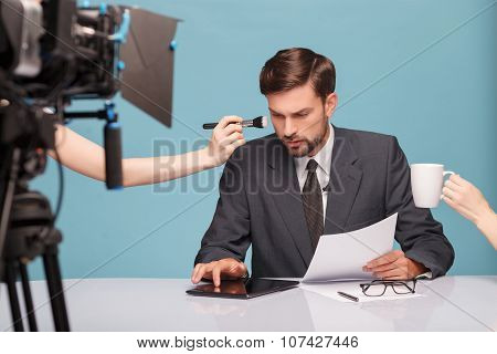 Cheerful male reporter before telling some news