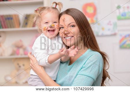 Pretty friendly family is spending time with joy