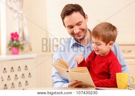 Pretty parent is spending time with his kid