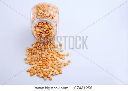 uncooked indian dhal lentil in a glass container