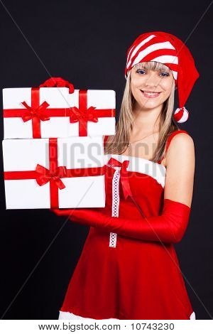 Santa Girl Holding The Box With Gifts. Holidays New Years And Christmas