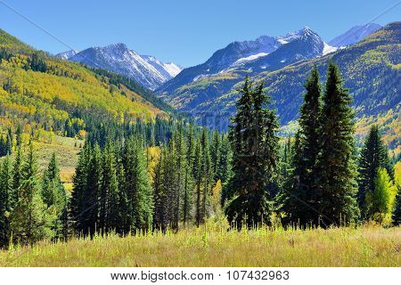 Alpine Landscape With Snow Covered Mountains In Colorado During Foliage