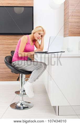 upset woman using laptop unhappy negative emotion