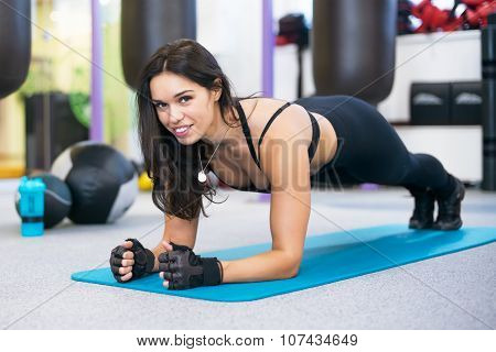 training fitness woman doing plank core exercise working out for back spine and posture Concept pila