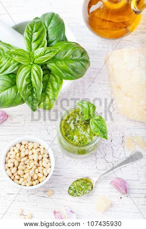 Basil pesto sauce and fresh ingredients. Top view