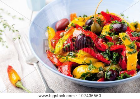 Roasted yellow and red bell pepper salad. Grilled vegetables.