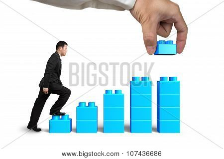 Businessman Steps Up Bar Graph Stairs Hand Holding Block Complete