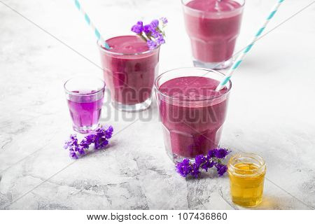 Blueberry, blackberry, honeysuckle, honeyberry smoothie with violet syrup and acai.
