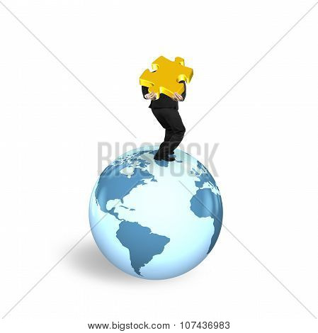 Man Carrying Jigsaw Puzzle Standing On Globe World Map