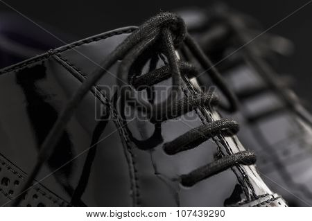 Footwear Concept. Horizontal Image. Pair Of Black Female Classic Leather Shoes On The Black Backgrou